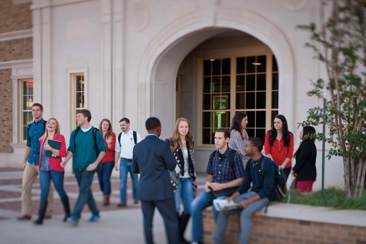 Students outside the Rawls College of Business at Texas Tech University