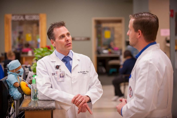 Eric J. MacLaughlin speaks to a colleague at Texas Tech University Health Sciences Center at Amarillo