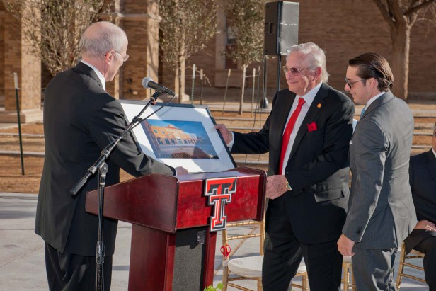 Kent Hance presents a commemorative photo to Bob L. Herd and grandson Michael Herd