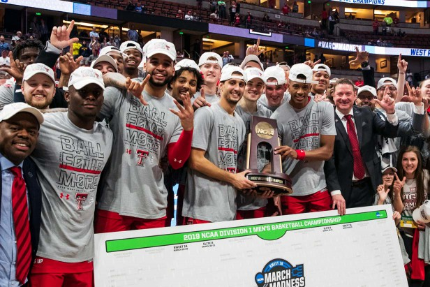 Texas Tech men's basketball team posing with the West Regional trophy