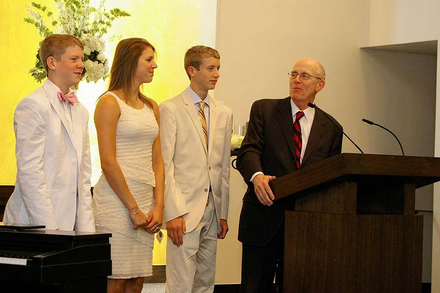 Chancellor Hance speaks to his grandchildren