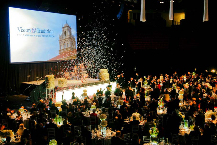 Confetti falls on guests at the campaign gala