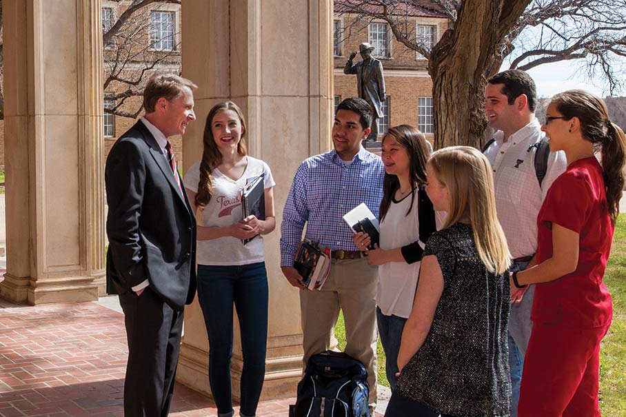 Chancellor Robert L. Duncan talking with students