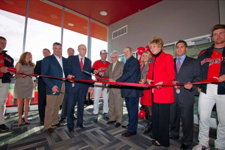 Texas Tech officials and donors prepare to cut the ribbon opening the facility