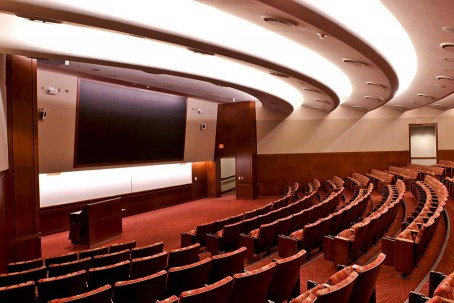 Large theatre-style classroom with video display