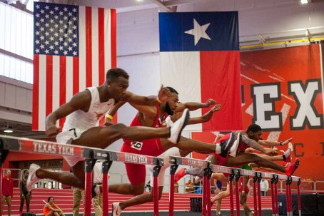 Hurdlers race inside the Sports Performance Center