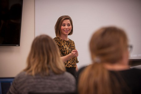 Courtney Meyers lectures to a classroom of students