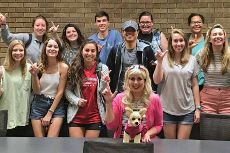 Wendy-Adele Humphrey as Elle Woods with pre-law students