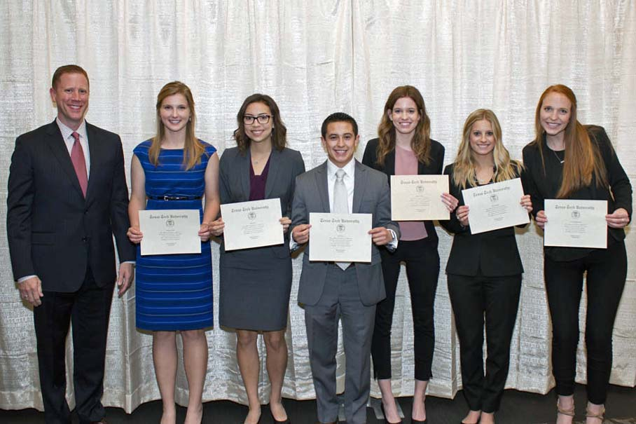 Michael Bodwell with scholarship recipients