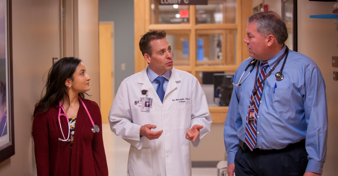Eric J. MacLaughlin talks with colleagues at Texas Tech University Health Sciences Center