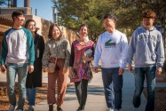 Susana Badiola walking with students on the Angelo State University campus
