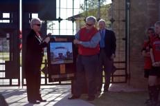 Gerald Meyer presents a framed print to John Walker