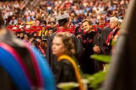 Lawrence Schovanec congratulates a Texas Tech University student at commencement